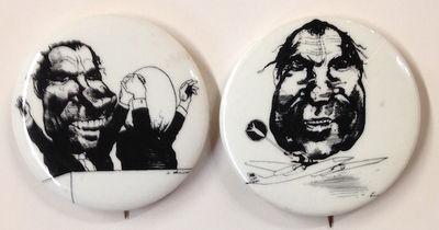 n.p.: NPAC, 1971. Two 1.75 inch diameter pins, both with cartoons by Levine that were originally pub...