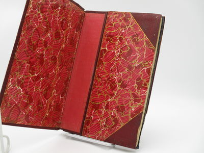 St. Louis. : Fred P. Kaiser. , 1900 . Full red morocco, no cover titles.. Good plus, foot of spine b...