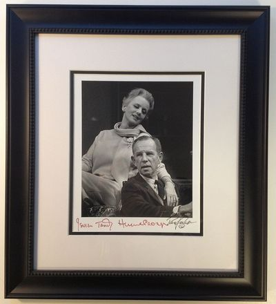 1975. unbound. 9.5 x 7.75-inch black-and-white photo of Tandy sitting behind Cronyn with her arm dra...