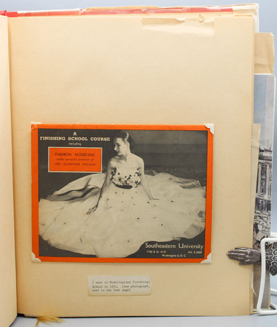 Original red binder with part of a silver Bergdorf Goodman box pasted onto front cover and a floral...