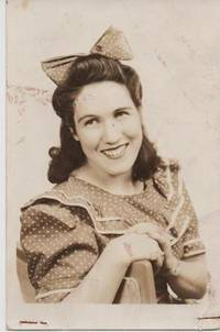 REAL-PHOTO POSTCARD OF TEXAS LILL:  Wearing a polka-dot dress and a large, matching bow on her...