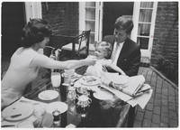 [Photograph of John, Jackie and Caroline Kennedy at Their Georgetown Home in 1959]