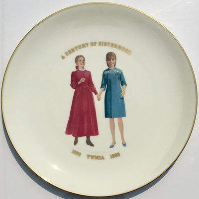 : Narumi Fine China, 1969. 29 cm diamter Gold border on bone china with an image of two women at the...