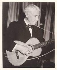 image of Original photograph of Carl Sandburg playing the guitar, circa 1955