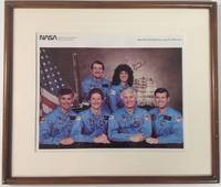 Framed NASA photograph signed by the entire six-member crew