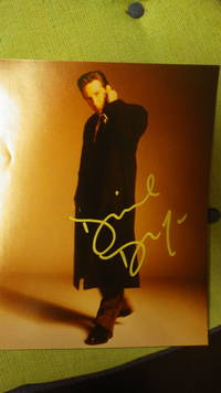 David Duchovny of X-Files TV Show, SIGNED Color Photograph of him in Long Black Coat with Hand Behind His Neck