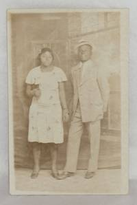 [Postcard with African American man and woman]