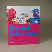 image of Daniel Johnston, with contributions by Jad Fair, Philippe Vergne, Harvey Pekar and an interview with Daniel Johnston