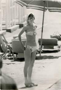 Audrey Hepburn in bikini at the beach, circa 1967 (Original oversize Swedish press photograph)