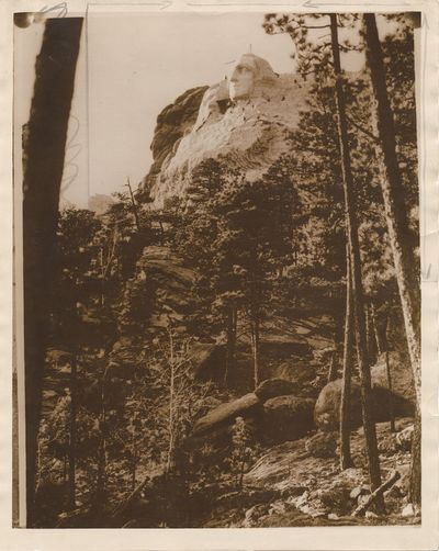 One photograph is a copy print showing George Washington's image carved into the mountain. The frame...