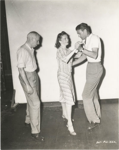 Culver City, CA: RKO Radio Pictures, 1941. Vintage borderless reference photograph of a concentratin...