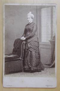 Cabinet Photograph. Studio Portrait of a Lady Beside a Chair.
