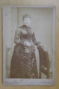 Cabinet Photograph. Studio Portrait of a Finely Dressed Lady.