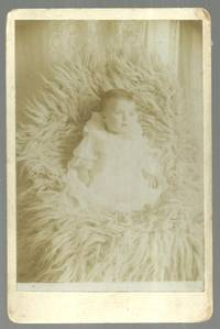 CABINET CARD OF BABY ON LARGE FUR RUG, LOUI GHUEY PHOTOGRAPH GALLERY