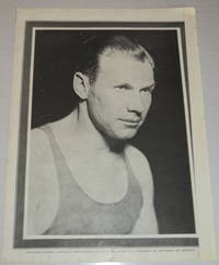 A vintage magazine photographic portrait of the AMERICAN OLYMPIC SPRINTER CHARLEY PADDOCK, who won several gold medals and set world records.