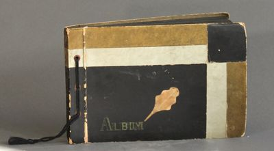 . Oblong album containing 157 photographs on 48 pages, dated between 1905-1940, with the majority of...