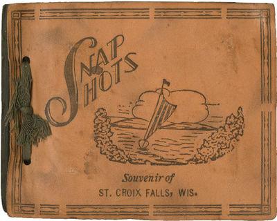 St. Croix Falls, WI: N.p., 1940. Vintage stringbound photograph album, containing 31 black-and-white...