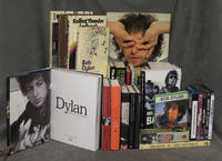 Collection of Bob Dylan books, CDs, VHS tapes, and DVDs featuring 56 books (3 of which are duplicates), 11 DVDS total (3 2-disc sets + 8 single discs), 5 CDs total (a 4-disc box + 1), and 2 VHS tapes; Lot of primarily books forming a good foundational collection of Dylan Studies including several rare and obscure items ranging in date from 1967-2012; Major titles include Bob Dylan: A Retrospective, Writings and Drawings, Rolling Thunder Logbook, No Direction Home, Wanted Man, The Recording Sessions, Down the Highway, In his Own Words, Behind the Shades Revisited, Bob Dylan in America, Who is That Man, The Last Waltz, Don't Look Back