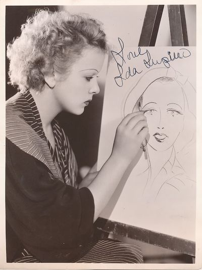 Lupino is shown seated at an easel with pencil in hand sketching a woman's face, perhaps herself. Th...