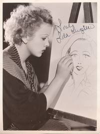 Early Signed Photograph with Paramount studio caption on verso, stamped June 29, 1934