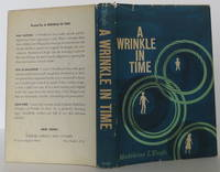 A Wrinkle in Time by Madeleine L'Engle - Signed First Edition - 1962 - from Bookbid Rare Books (SKU: 2001101)