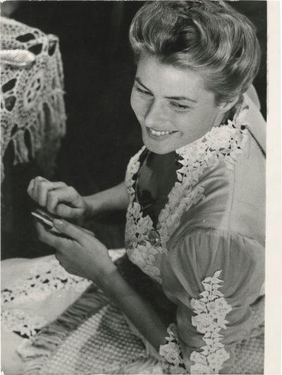 N.p.: N.p., 1956. Vintage oversize borderless reference photograph of actress Ingrid Bergman filing ...