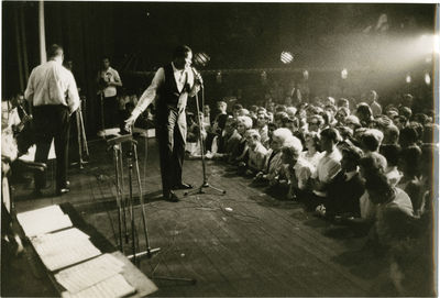 N.p.: N.p., 1963. Archive of eleven double weight photographs of Chubby Checker in concert, apparent...