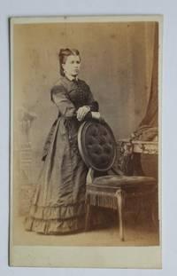 Carte De Visite Photograph. A Studio Portrait of a Lady Beside a Chair.