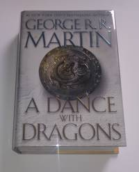 A Dance with Dragons by George R. R. Martin - Signed First Edition - 2011 - from PostLiterate Books  and Biblio.com