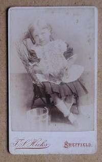 Carte De Visite Photograph. Portrait of a Young Girl Seated on a Wicker Chair.