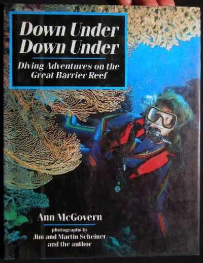 New York, NY: MacMillan, 1989. 48 pages; colorfully illustrated with underwater diving photographs o...