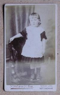 Carte De Visite Photograph. Portrait of a Young Girl Standing on a Chair.