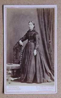 Carte De Visite Photograph: Portrait of a Young Woman in a Fine Dress Standing Beside a Chair.