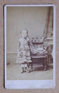Carte De Visite Photograph: Portrait of Young Girl Standing Beside a Chair, with a Photograph Album & Hat.