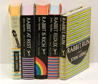 image of EACH  WITH A CARD SIGNED BY UPDIKE LAID IN: RABBIT, RUN (1960); RABBIT REDUX (1971); RABBIT IS RICH (1981); RABBIT AT REST (1990); and the novella