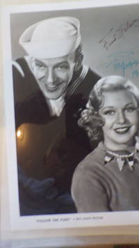 SIGNED  B/W  Photograph Ginger Rogers & Fred Astaire from Movie Follow the Fleet , with Fred in SailorS Suit & Ginger with Curly Hair in Sweater Both Smiling by  Fred Signed in Black Ink & Ginger Signed in Green Ink & Dated 1991 SIGNED  Ginger Rogers & Fred Astaire - Signed First Edition - from BLUFF PARK RARE BOOKS (SKU: 23543)