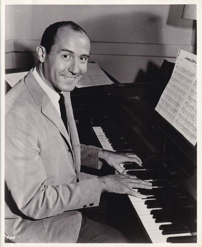 N.p.: N.p., 1961. Vintage publicity photograph of composer Henry Mancini from the 1961 film. With cr...