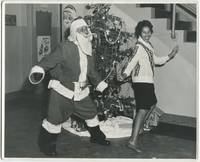 image of (Press photograph): Black Santa Does The Twist with a Black WAC