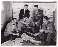 image of Alice in Wonderland (Original photograph of Walt Disney, Winston Hibler, Erdman Penner, and Ted Sears examining animation cels for the 1951 film)