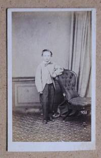 Carte De Visite Photograph: Portrait of Young Boy Standing Beside a Chair.