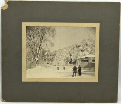 An albumen photograph of a major snowstorm in February 1898, showing a most wintry view of the State...