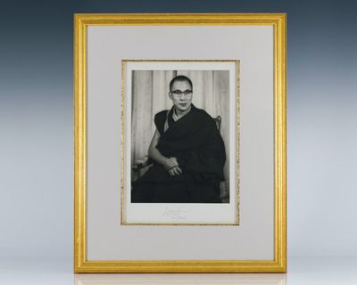 Large black and white of His Holiness The Dalai Lama. Signed and dated by him below. Double matted a...