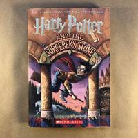 Harry Potter and the Sorcerer's Stone by  Mary [Illustrator]  J.K.; GrandPré - Paperback - First Edition - 1998 - from The Bookman & The Lady (SKU: Rowling-8)