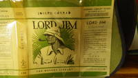 image of LORD JIM: A Tale  Stated First Modern Library Edition 1931  IN Green_White Early VINTAGE DJ with SIDE PROFILE FACE OF Man in Safari Hat smoking Pipe,  Theme of a heroic man