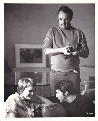 Los Angeles: Twentieth Century-Fox, 1969. Vintage reference photograph of director Peter Yates and a...