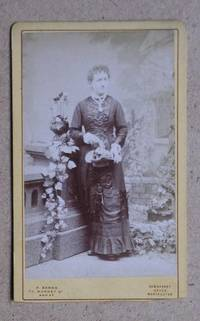 Carte De Visite Photograph: Portrait of a Young Woman with a Basket of Flowers.