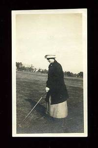 Unbound. Near Fine. Small black and white photograph of a woman golfer. Approximately 2.5