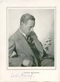 """PS. 9"""" x 12"""". No date. No place. A printed photograph signed """"Leslie Howard"""" in blue ink on ..."""