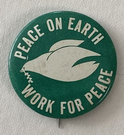 New York: mfg. by Columbia Advertising, . 1.5-inch button, dove on green field; light handling wear.