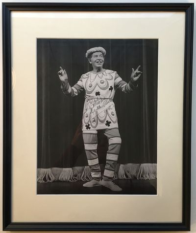 1974. unbound. 13 x 10-inch black-and-white photo of Berle on stage dressed in an outlandish costume...